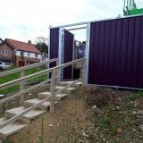 Experience noise control barrier on fencing Heras